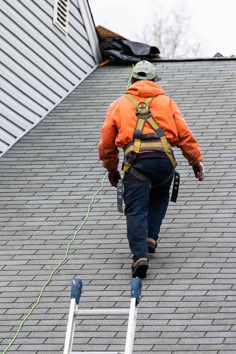 roofer doing emergency roof repair