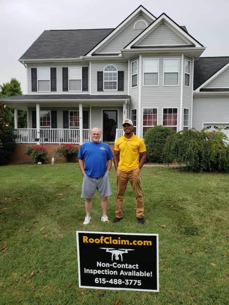 Atlanta Roof Replacement Customer in Front Yard with RoofClaim.com