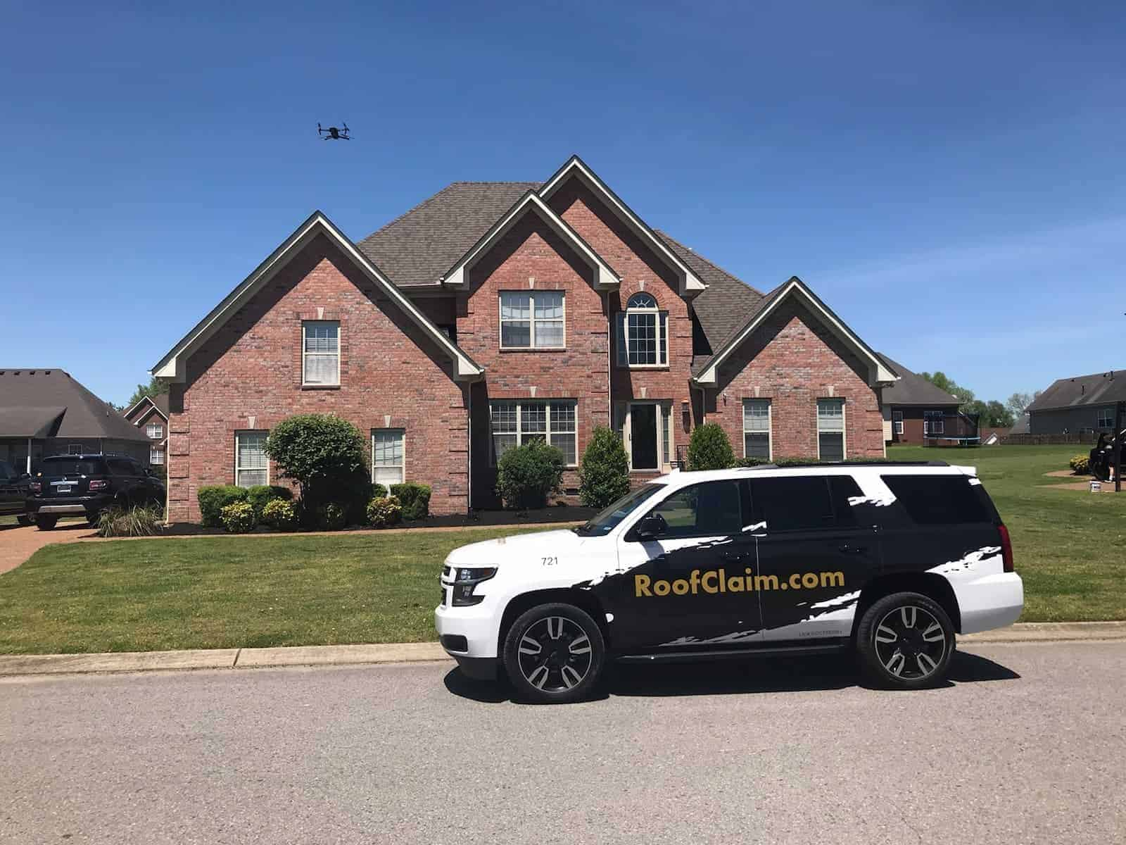 RoofClaim.com Doing Roof Inspection on Brick Home With Shingle Roof
