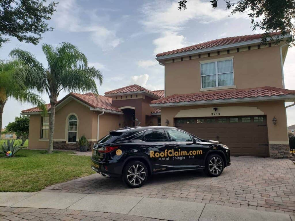 RoofClaim.com Truck In Front of Maitland Florida Home After Roof Replacement