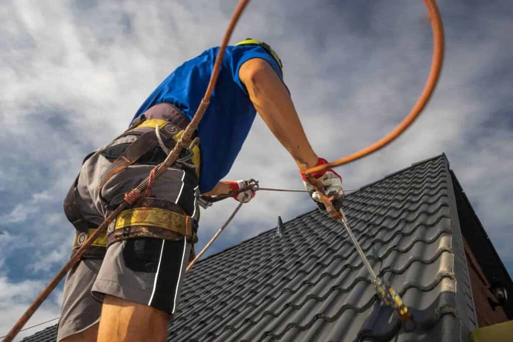 Roofer doing a free roof inspection on a tile roof