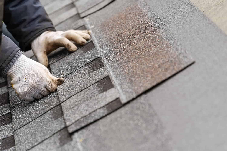 roofer performing emergency roof repair