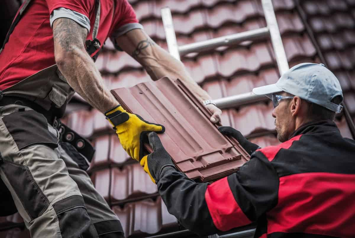 Roofers doing tile roof repair job