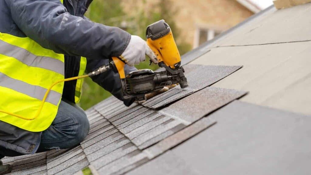 Roofing Contractor Repairing Roof in Evansville Indiana