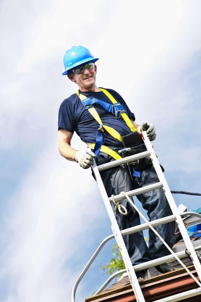 Roofer in Hard Hat on Ladder in Birmingham Alabama