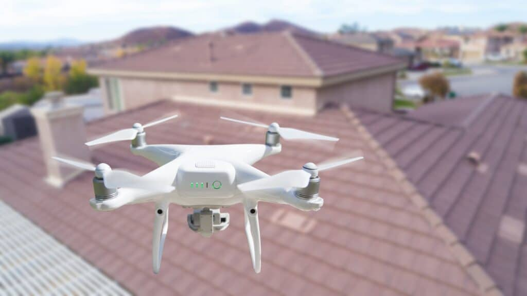 a drone inspecting a roof for roof leaks, roof damage, and doing a full roof inspection for homeowners insurance roof claim.
