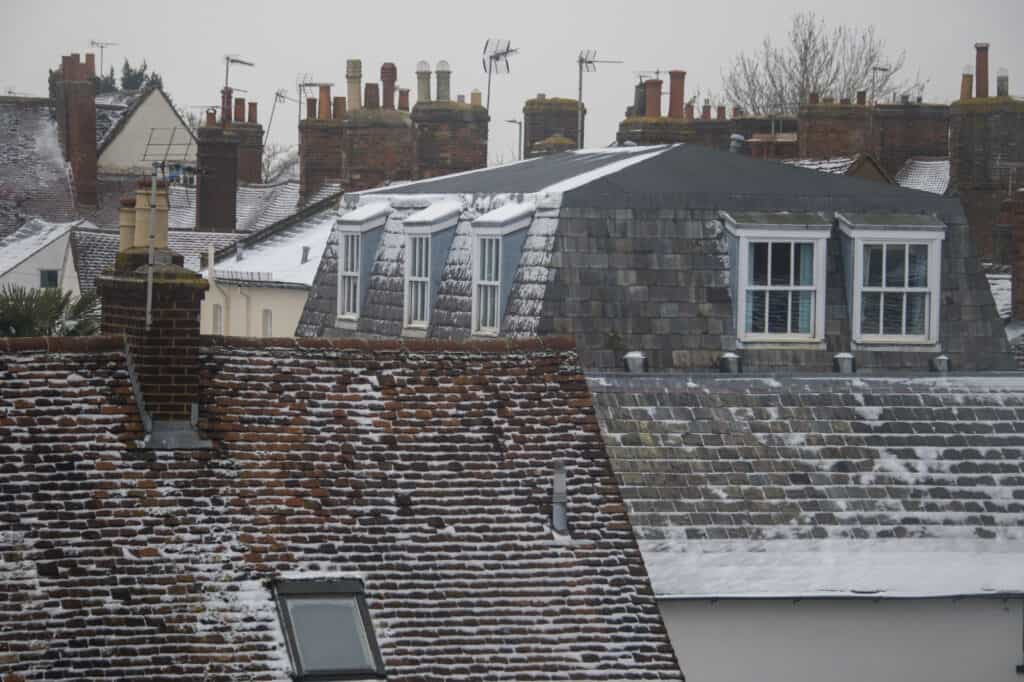 snow on roofs of houses